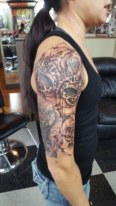 Half sleeve masquerade mask and rose tattoo