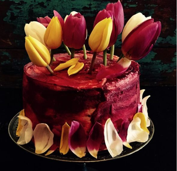 Spring Cake by Cakebread Cherry stained whitechocolate cake decorated with fresh tulips. Photography  Mari-Louis Guy
