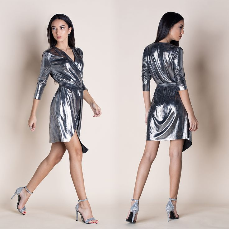 STAR SILVER WRAP DRESS --- Shimmer with every step you take in the Star Silver Wrap Dress. Lightweight metallic fabric forms this three-quarter sleeve stunner with a wrapping surplice bodice, and tying sash at the waist. Wrapped detail carries into a front slit asymmetric skirt for a sensational finish. Mini // Asymmetric // Wrap style // V-neckline // Belt included