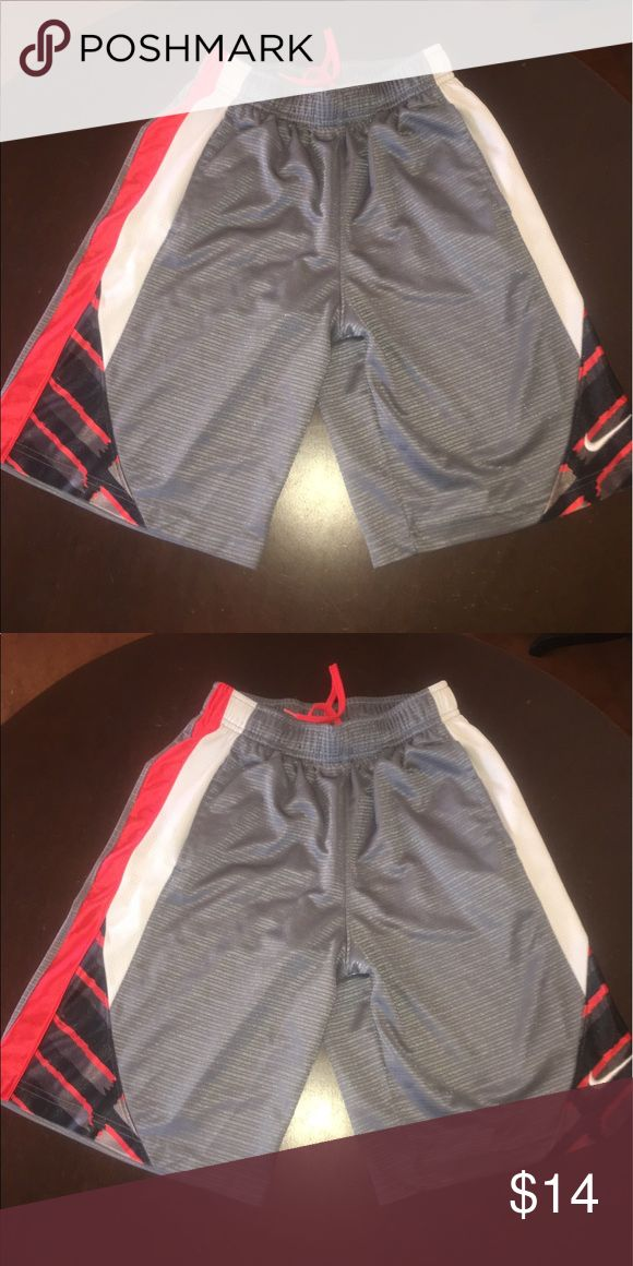 🏈🏈PREOWNED BOYS NIKE SHORTS  SIZE Medium 🏈🏈 🏈🏈BOYS PREOWNED NIKE SHORTS SIZE MEDIUM IN GREY AND RED SIZE MEDIUM.🏈REGULAR WEAR NO KNOW FLAWS STAINS ETC🏈 Nike Bottoms Shorts