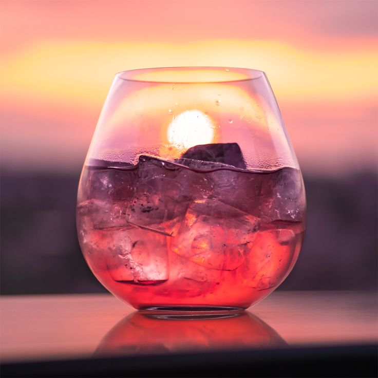 Toast the sunset with a Madras, an easy cocktail that's equal parts sweet and tangy. Simply mix equal parts orange and cranberry juice, add a shot of vodka and pour over ice.  #madras #cocktail #sunset #beachfront #bythesea #redsky #cocktailrecipes #cocktaillovers #cocktailtime #vodka #vodkacocktail #easycocktails #summer #photography