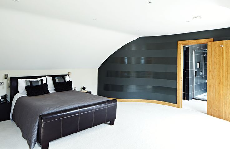 Bedroom with ensuite and glossy striped wallpaper made with paint and varnish. Like the idea of a curved wall