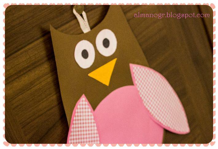 Οwl made of colored canson paper and fabric.