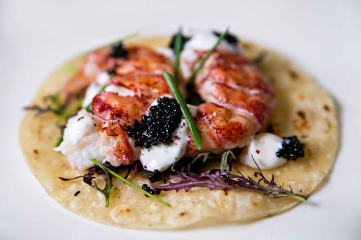 $100 Taco Trio + Margarita: The  Maine Lobster Taco – a soft buttery Maine lobster taco garnished with caviar pearls, petite mustard, aleppo chili, and lime crème fraiche served over a grilled white corn tortilla #fsdallaseats