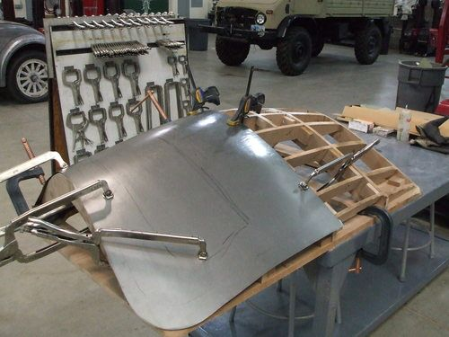 Buck form with sheet metal fitted to it. This is a buck for a replacement trunk skin without the license plate recess for a 1950 Ford Custom. Material is 18 gauge mild steel.