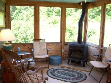 Cozy wood stove in screened in porch great idea dream for Wood burning stove for screened porch