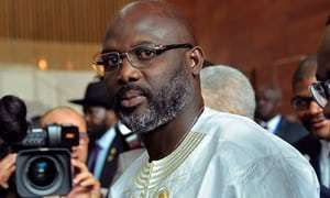 Liberia's George Weah slashes his salary and vows to change 'racist' constitution