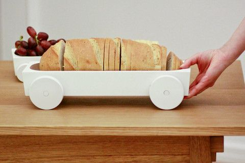 Bring a little fun to the dining table, by adding some wheels to your meal. This finely crafted kart is perfect for displaying an hours d'oeuvre, or even jewelry on your bureau. Designed and made by Y'A PAS Le FEU AU LAC.