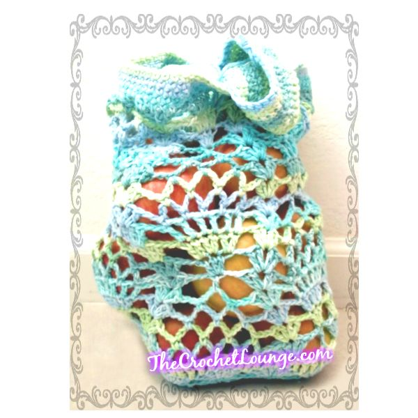 "Pineapple Lace Market Bag - The Summer Elegance Edition by ""e"" Lee The Crochet Lounge   Free Pattern: http://thecrochetlounge.com/pineapple-lace-market-bag-summer-elegance-edition/  #TheCrochetLounge #crochet #free #pattern #pineapple #lace #marketbag"