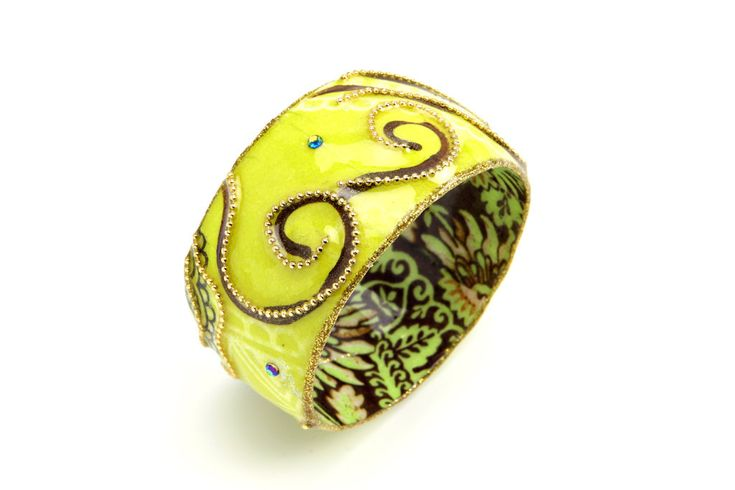 Wide bangle with colorful yellow, gold and brown print coated resin.. $69.00, via Etsy.
