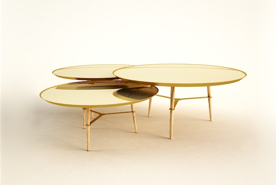 A group of sleek nesting tables with mirror tops to reflect the wood on the underside when arranged together.  http://danielduarte.pt/