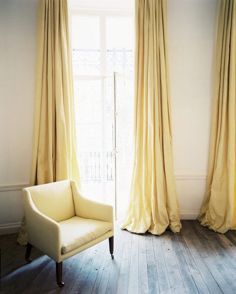 Puddel March 2013 Issue Photo - Yellow curtains flanking french doors leading to a balcony