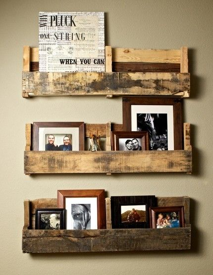 Like the rustic-ness of these bookshelves.  Slice a wood pallet horizontally to create a few separate shelving unites to hold pictures, books, and magazines. ** Note: You may have to add some sort of wood support underneath each separate pallet/shelf.