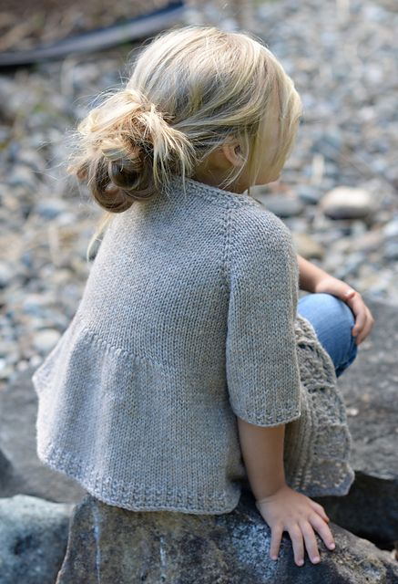 Cove Cardigan knit pattern by Heidi May (back view). Classic Wool Worsted by Patons North America. Pattern in 5 sizes: 2/3, 4/5, 6/7, 8/9, 10/11 years. US size 8/5.0 mm, 420 - 710 yards / 384 - 649 m.