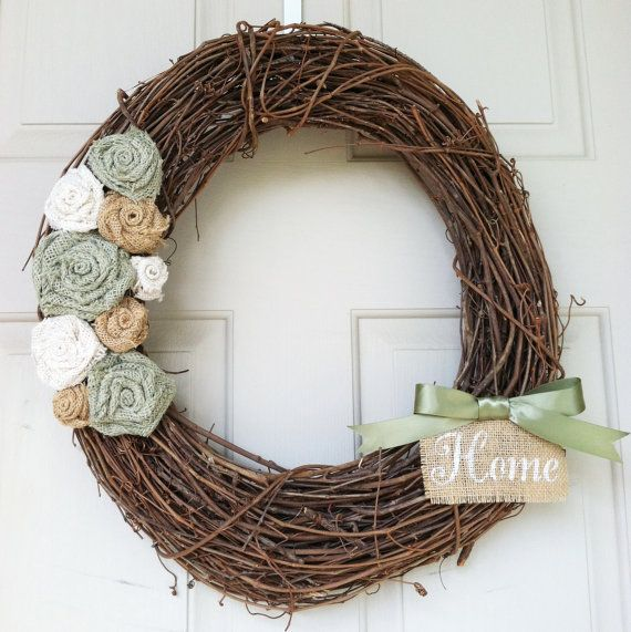18 inch Custom Grapevine Wreath with Burlap Rosettes and Painted Banner. $39.00, via Etsy.