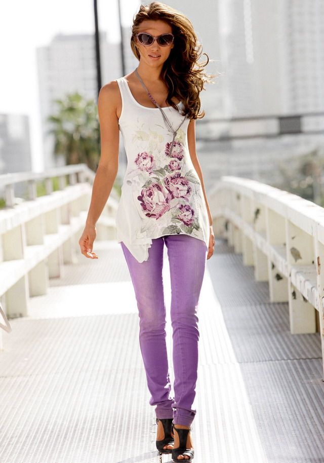White long tank top with flower print and purple colored jeans