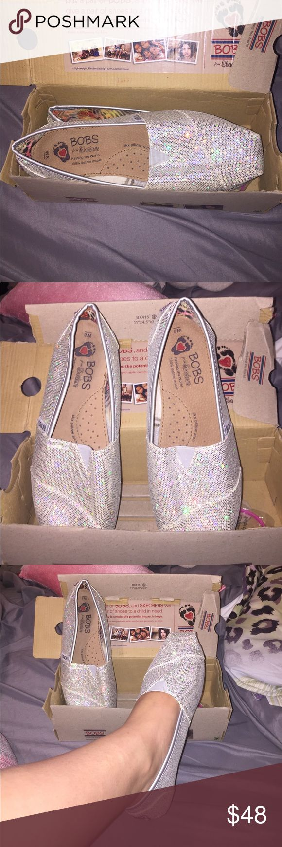 """BOBS sparkly silver slide ons NEVER WORN BOB's sparkly silver shoes. Includes box and pink bracelet that states """"make a difference for kids. NEVER WORN, in new perfect condition. Size 8. BOBS from skechers Shoes Flats & Loafers"""