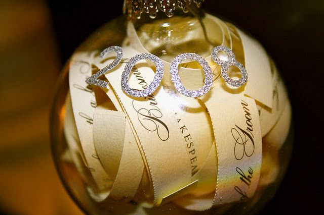 Cut your wedding invitation into strips and make it into a Christmas ornament you can have as a keepsake forever!