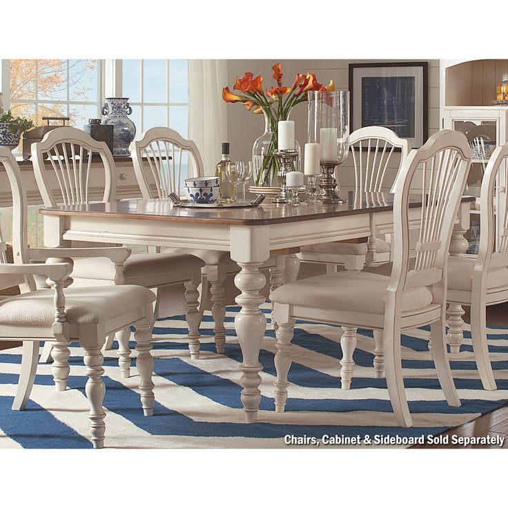 """The 44"""" x 72"""" table has a contrasting grain & dark finish top & Antique White base. Two additional 18"""" leaves are included, extending the table to 108"""", for seating up to eight guests."""