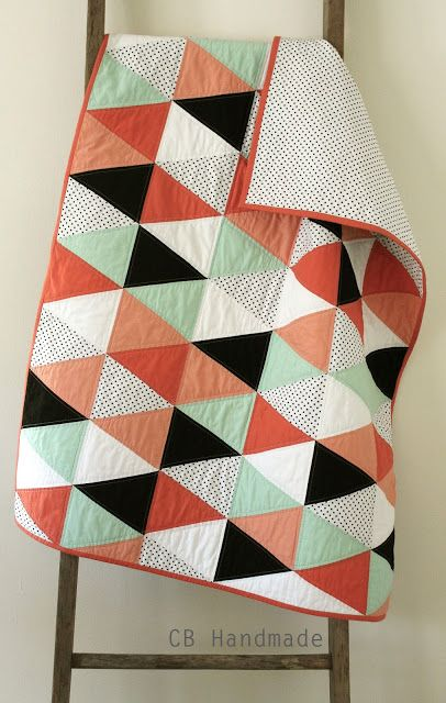 a coral and mint isosceles quilt. Handmade by Erica Sage of CB Handmade (craftyblossom.blogspot.com)