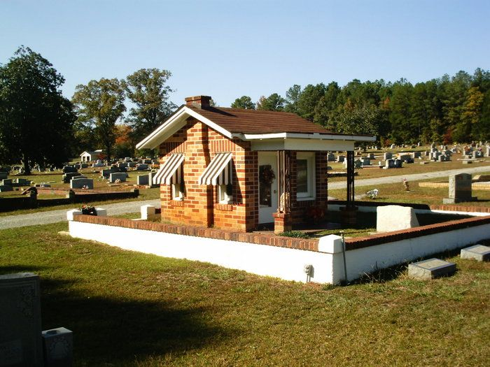 Four-year-old Nadine Earles wanted a doll house for Christmas, but she died on Dec. 18, 1933. Her grieving parents had a doll house built around the grave with her toys and other personal belongings placed inside: dolls, stuffed animals, a tea set, her high chair and tricycle. Mom Alma was buried on the front lawn when she passed in 1981. Oakwood Cemetery, Lanett, Alabama.