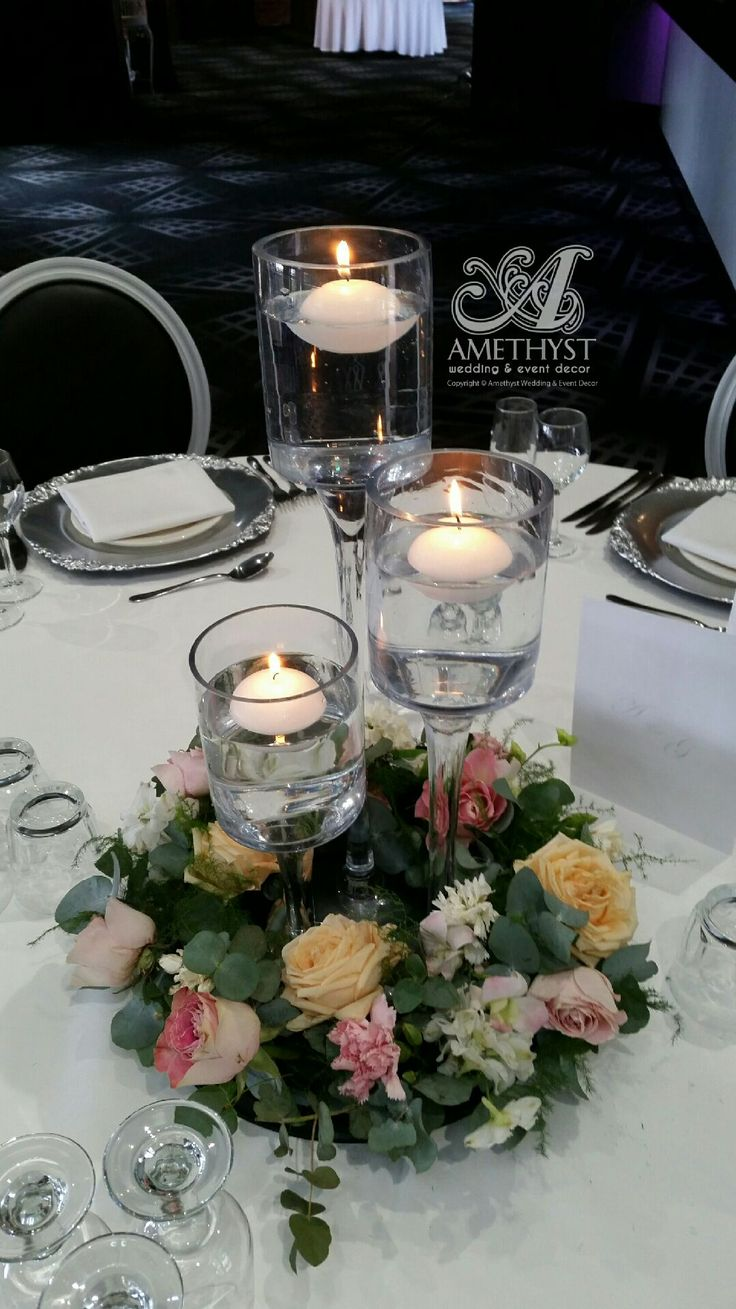 Floral wreath for centrepieces. Flowers and styling by Flowers With Elegance. Www.flowerswithelegance.net