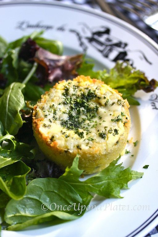 Warm Savory Mini-Cheesecakes with Dressed Baby Greens _ Warm, creamy little cheesecakes liven up the simply dressed, crispy greens. Rich, yet light & tender, it was love at first bite ~ the delicate cheesecake practically melts in your mouth. Whipped cream cheese, a little sour cream,eggs & a few crumbles of blue cheese are the key ingredients.