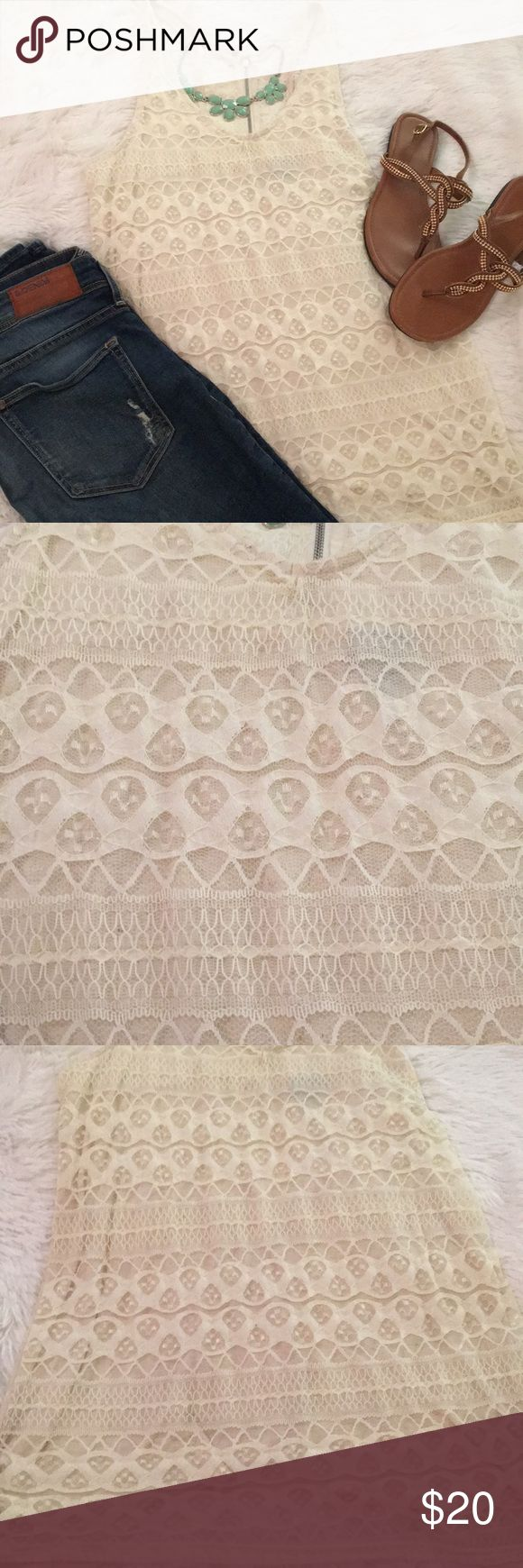Lace tank top Ivory lace tank top. Racer back with zipper. Worn only once or twice!  🚫TRADES 🚫LOWBALL OFFERS  ⭐️ BUNDLE TO SAVE!! Vanity Tops Tank Tops