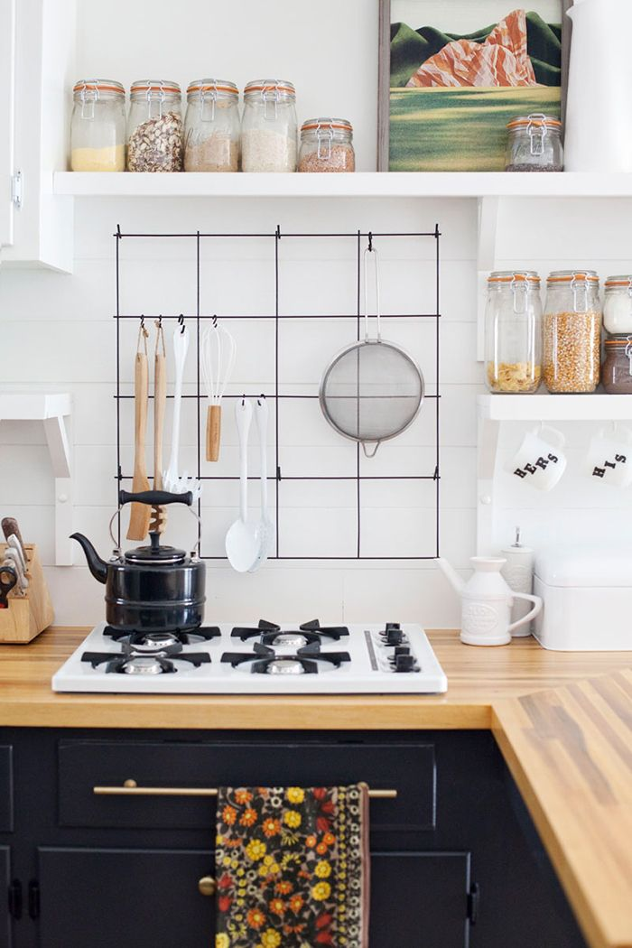 Gorgeous industrial style and organization with a wire utensil rack - DIY Kitchen ideas