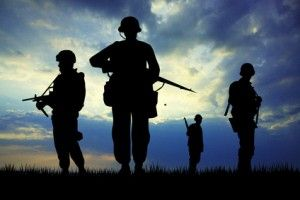 Soldiers silhouette at sunset