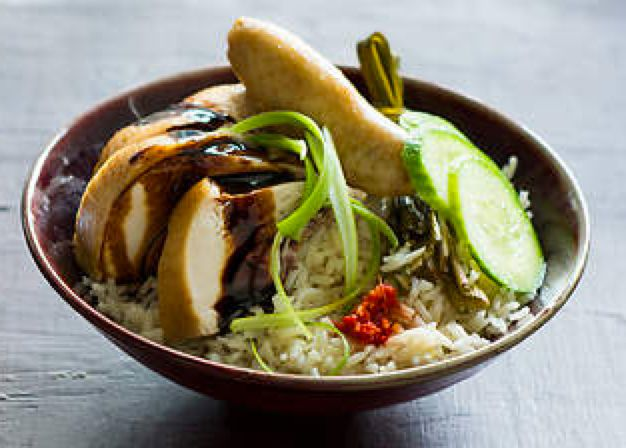 Hainanese Chicken Rice - A much-loved Chinese classic, this Singaporean recipe is an interpretation of chicken rice, using pandan, kecap manis and cucumber to complement the balance of flavours. http://www.sbs.com.au/food/recipes/hainanese-chicken-rice