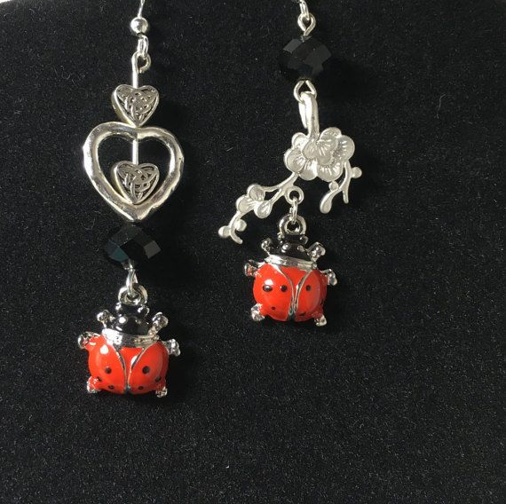 Valentine's Day or earrings for your Valentine, Ladybug earrings. Cute Cherry Red, black and silver Love Bug charms dangle with Celtic hearts. Just like nature, this pair of earrings is designed to be similar but not identical. Earring wire options are available. Gift your Sweetheart, or celebrate Mom or a July Birthday. Perhaps a perfect retirement gift for the avid Gardener. Earring Details - small ladybug charms: red and black enamel on silver metal (about .50 inches / 1.5 cm) - flower s