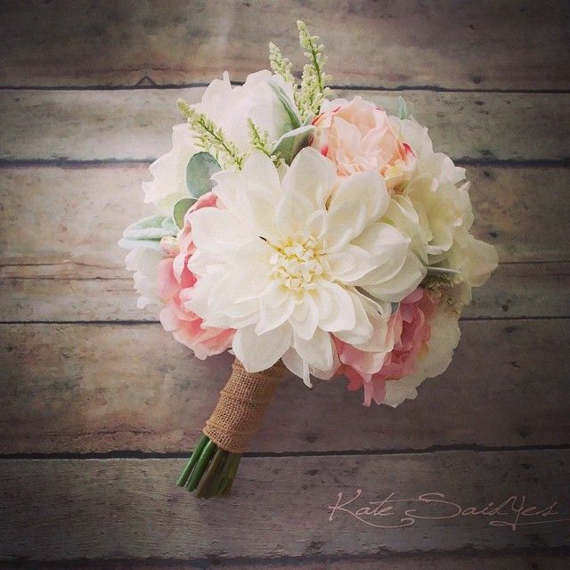 Love this arrangement of ivory and blush pink dahlias roses peonies and lamb's ear! By Kate Said Yes Weddings http://ift.tt/1DWzqgQ