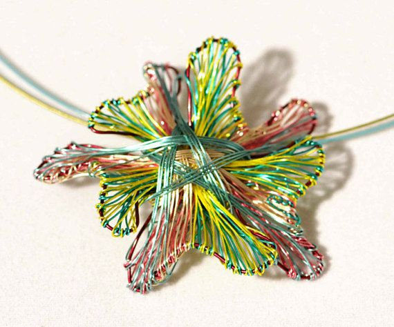 #Flowerpendant #Flowernecklace #Limegreen necklace #Flowerjewelry #Wirejewelry #Flowerstatementnecklace #Uniquenecklacesforwomen #vmikro #etsy  This is a handmade flower pendant wire necklace, flower art jewelry. This lime green necklace is made of colored copper and silver wire. Overall size of the flower statement, unique necklace for women , is 3cm (1,18in). The flower statement necklace gift hanging from steel wire and the clip is handmade silver. Very easy and safe to snap.