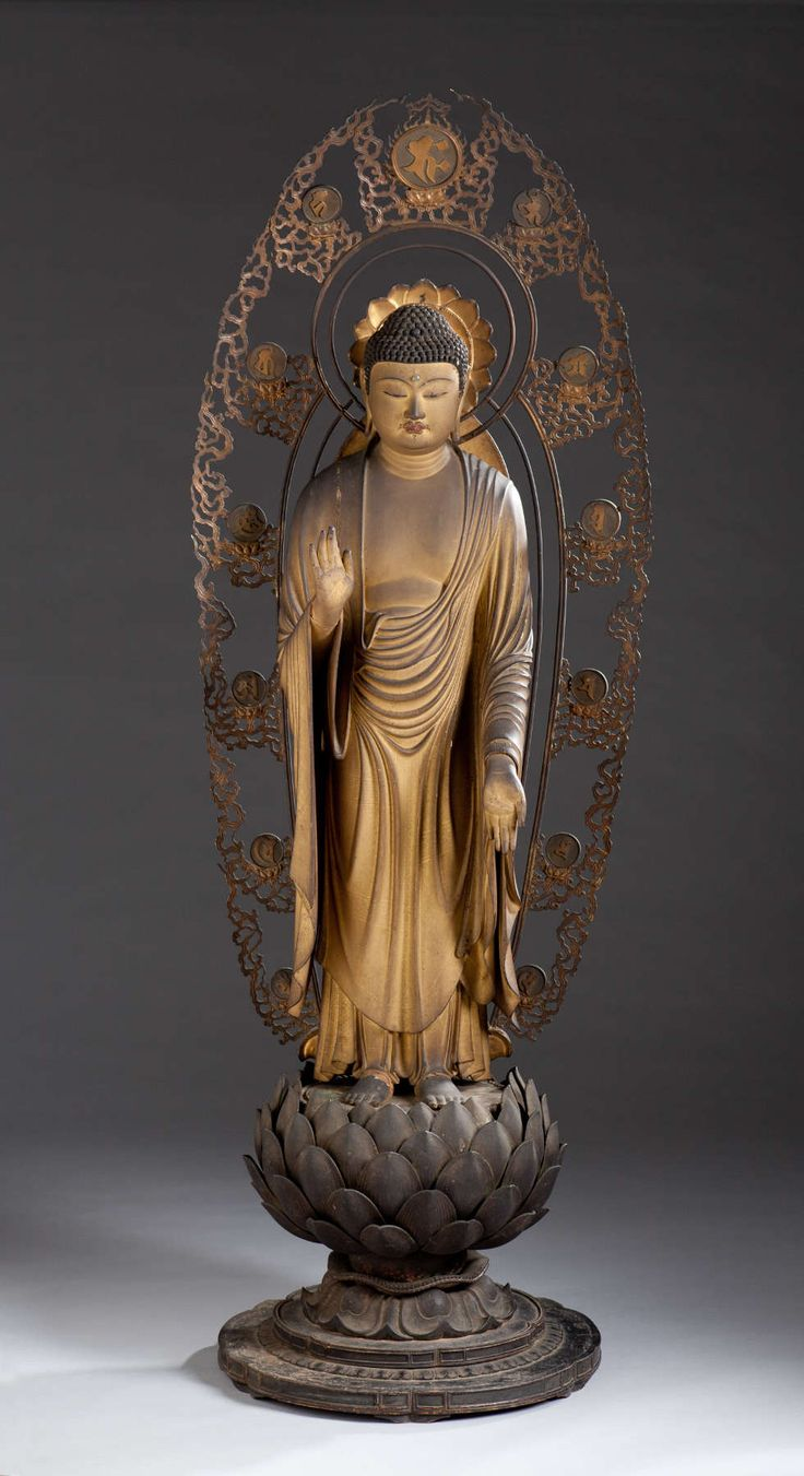 Kaikei (active ca. 1183–1223). Standing Shaka Buddha. Kamakura period, ca. 1210. Gold-painted (kindei) and lacquered wood with cut gold leaf (kirikane) and crystal urna. Kimbell Art Museum, Fort Worth, Texas: AP 1984.01 a,b,c.Photography: Kimbell Art Museum, Fort Worth, Texas