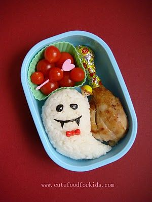 Ghost Onigiri ( rice ball) Bento: There are only 3 items in this bento. In the muffin cup are tomatoes from our back yard; the chicken drumstick is leftover from the night before; a plain rice ball. A simple lunch that contains veggie, protein and carbs!