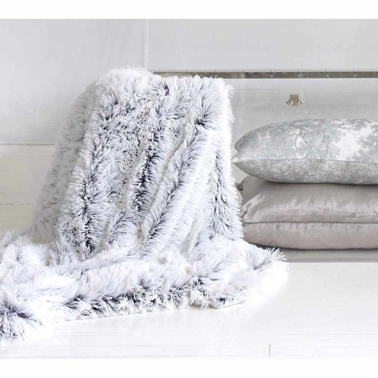 Cotton Tail Grey Faux Fur Throw - French Bedroom Throw -  Made up of many strands that are black at the base and white at the tips, giving it a really luxurious look at it moves. We love it layered against crisp whites and cool greys, but it also looks pretty against pale pinks too.
