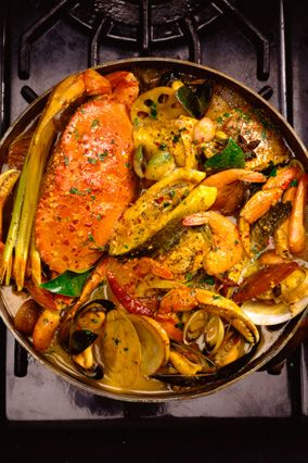 Boo-yah Bouillabaisse - With shrimp, crabmeat, sea scallops and flaky white fish such as snapper or cod, it's a hearty, warm stew, begun on the stove top and finished off in the oven.
