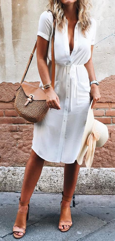 Knee length button up white dress, perfect summer style with a woven bag and large summer hat.