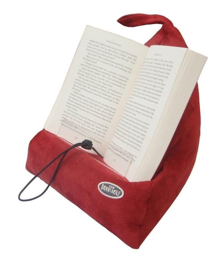 A Book Holder That Is Also A Travel Pillow For The Person