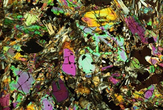 Moon rocks like you've never seen them before! We generally tend to think of the moon in... oh, about 50,000 shades of grey, as it were.    However, samples returned to Earth are just full of secrets at many levels. BEHOLD! The microscopic colors of Luna Selene...
