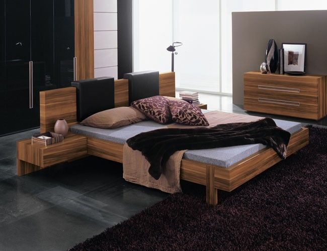 The bed features wide linear headboard design and straight