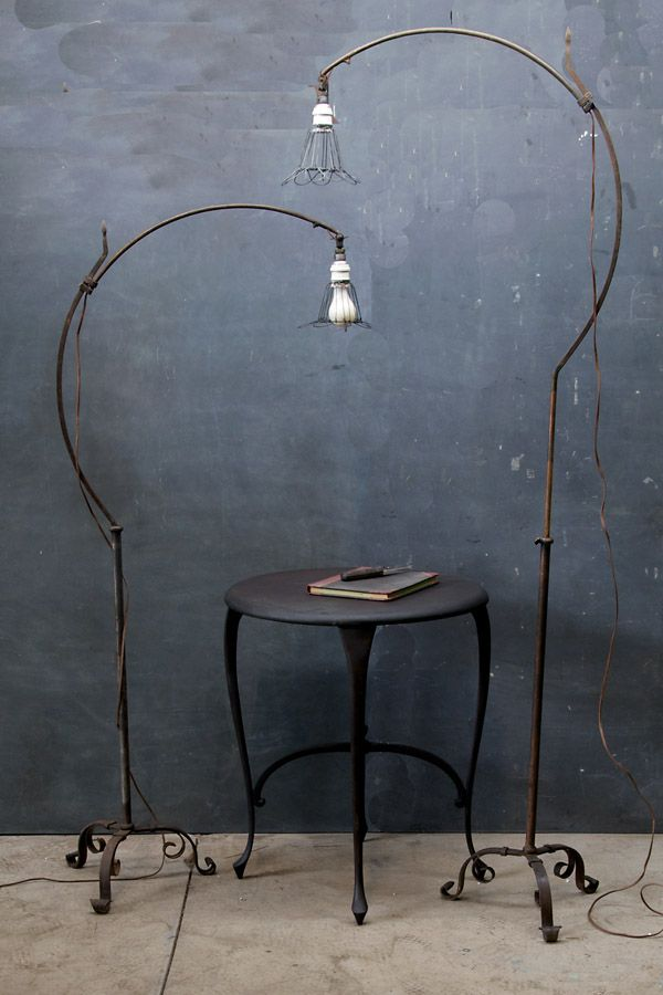 Quirky 1930s Belgian industrial hand-forged floor lamps.