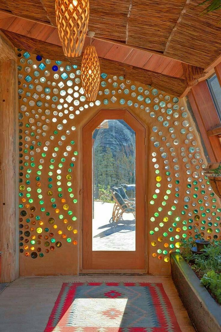 Glass bottles added during cob construction bring more light into the room.