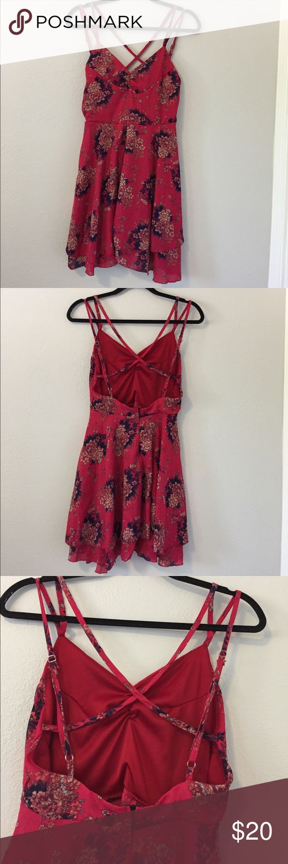 "‼️SALE‼️ Beautiful and Whimsical Pink Floral Print Dress. It has scrunching on the bust, and cris cross adjustable spaghetti straps. It has an open back and he Zipper begins just above the lower back. It is Fitted up too, and flairs out in a flowy layered skirt. I wear a 6, & it was just a bit too snug & short for my comfort, I would compare it more to a 4. Approx measurements laying flat: waist side to side: 13"", pit to waist: 4"", waist to hem: 18"" & 16"" as it has a layered effect to it…"