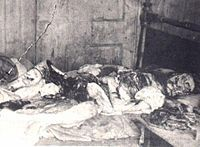 Police photograph of the body of Mary Jane Kelly as discovered at 13 Miller's Court