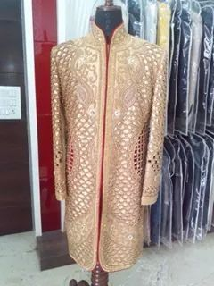 Cutwork royal design goldn row silk fabric