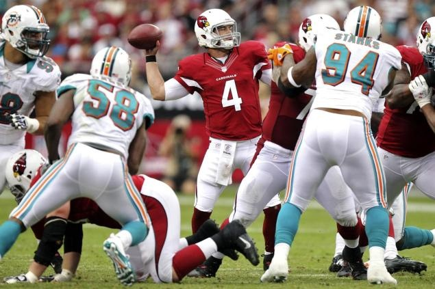 Arizona Cardinals quarterback Kevin Kolb (4) throws against the Miami Dolphins during the second half of an NFL football game, Sunday, Sept. 30, 2012, in Glendale, Ariz. (AP Photo/Paul Connors)