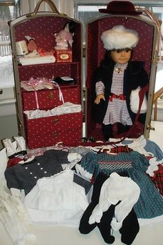 """Here's a Samantha doll (condition listed as """"used"""") priced at $599 — she comes with several outfits and accessories.   How Much Is An Original American Girl Doll Worth?"""