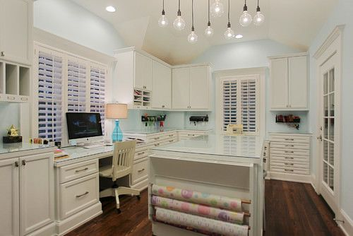 Gorgeous White Craft Room and Home Office with Gift Wrapping Station, Mint Walls and Dark Wood Flooring.